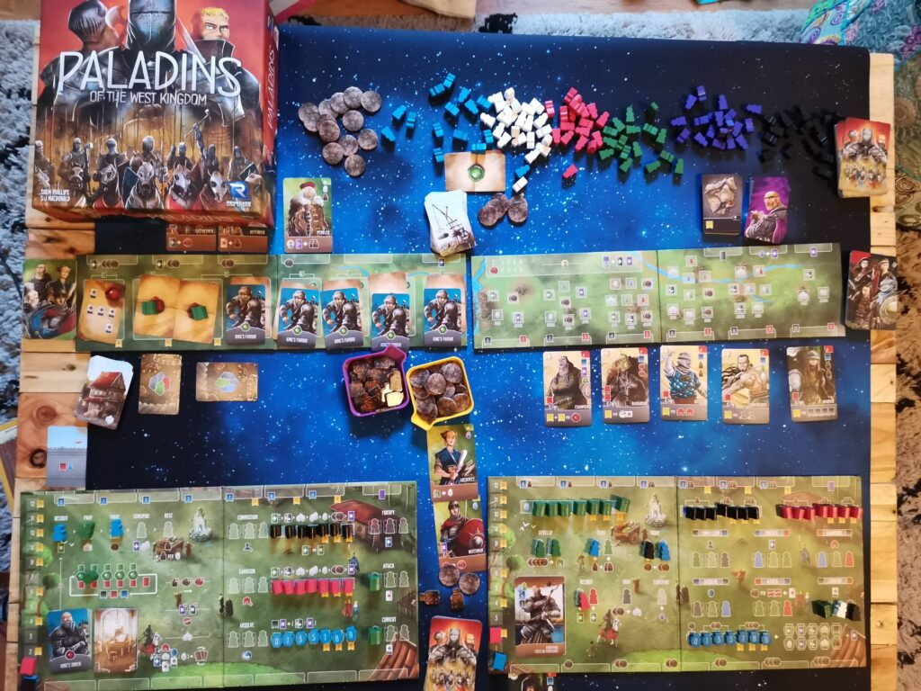 an overhead view of the game setup for Paladins of the West Kingdom