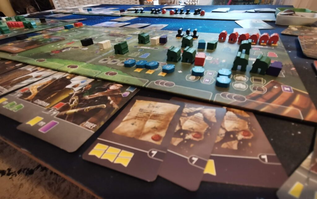 a close-up of the Paladins of the West Kingdom player board and cards