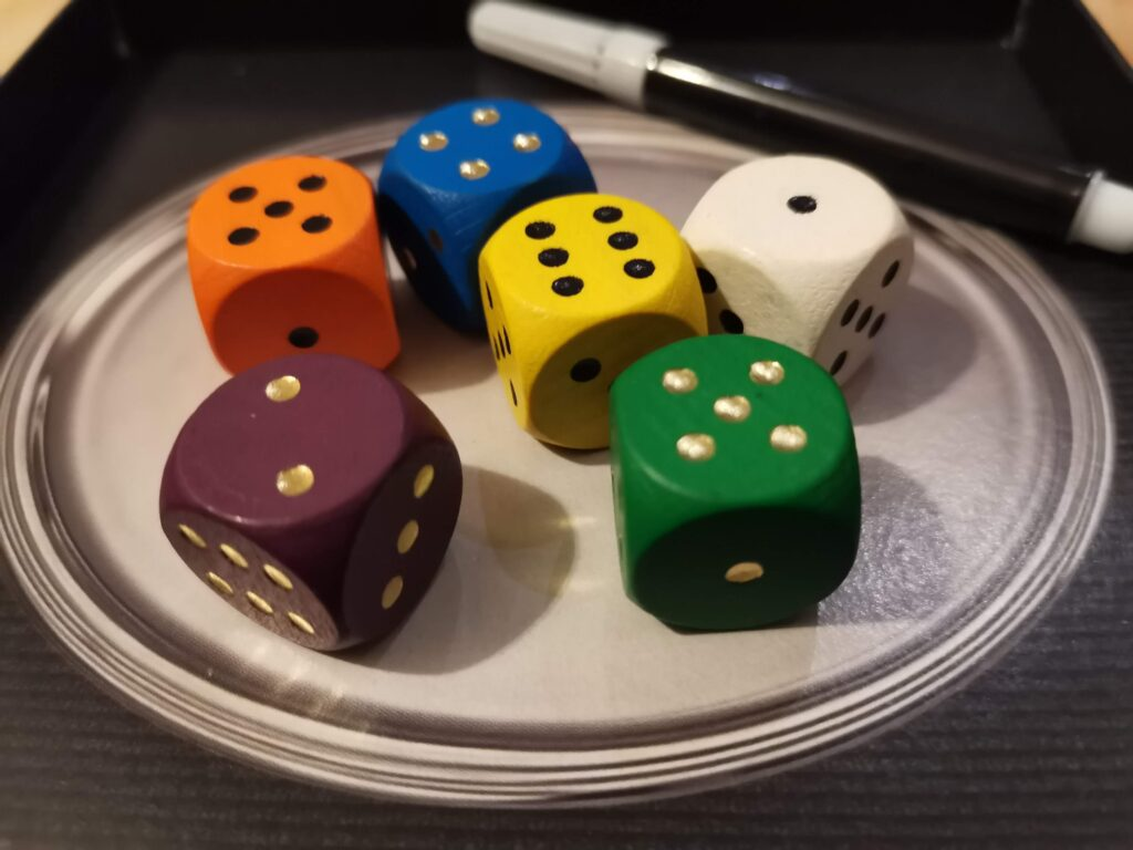 coloured dice on the silver tray