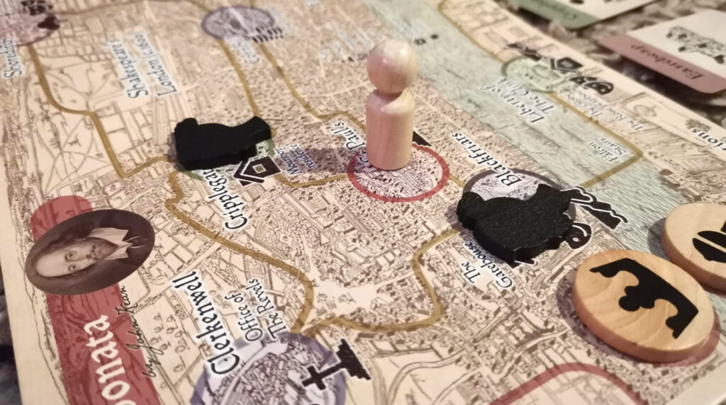 black sonata pawn and dark lady tokens on the game board