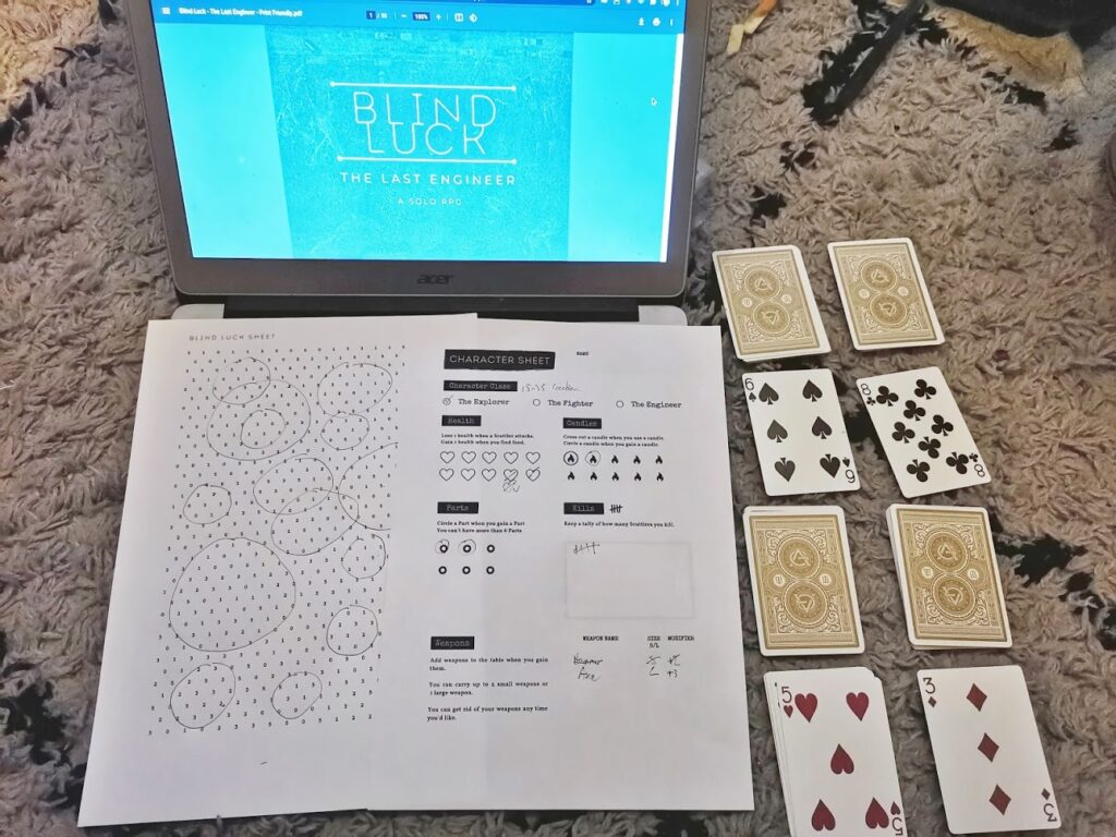 blind luck in play with cards and a laptop